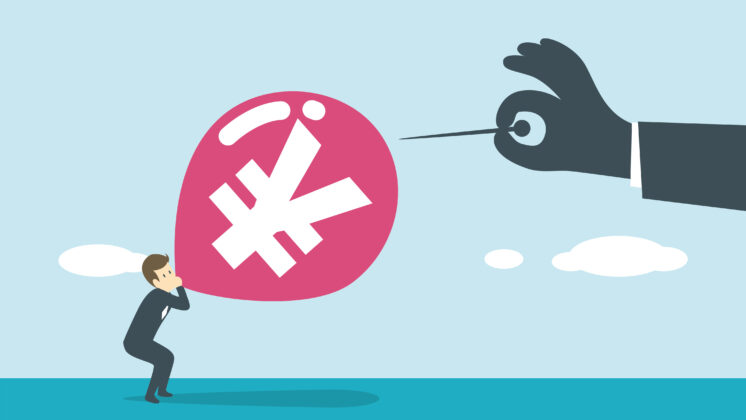 Illustration of a man blowing up an inflated balloon with a yen symbol on it while a large hand holding a pin prepares to cause the economic bubble burst