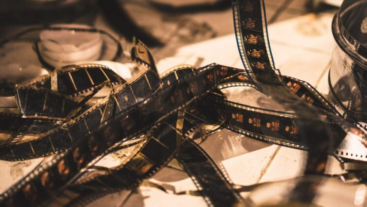 Traditional black film lies on the table.