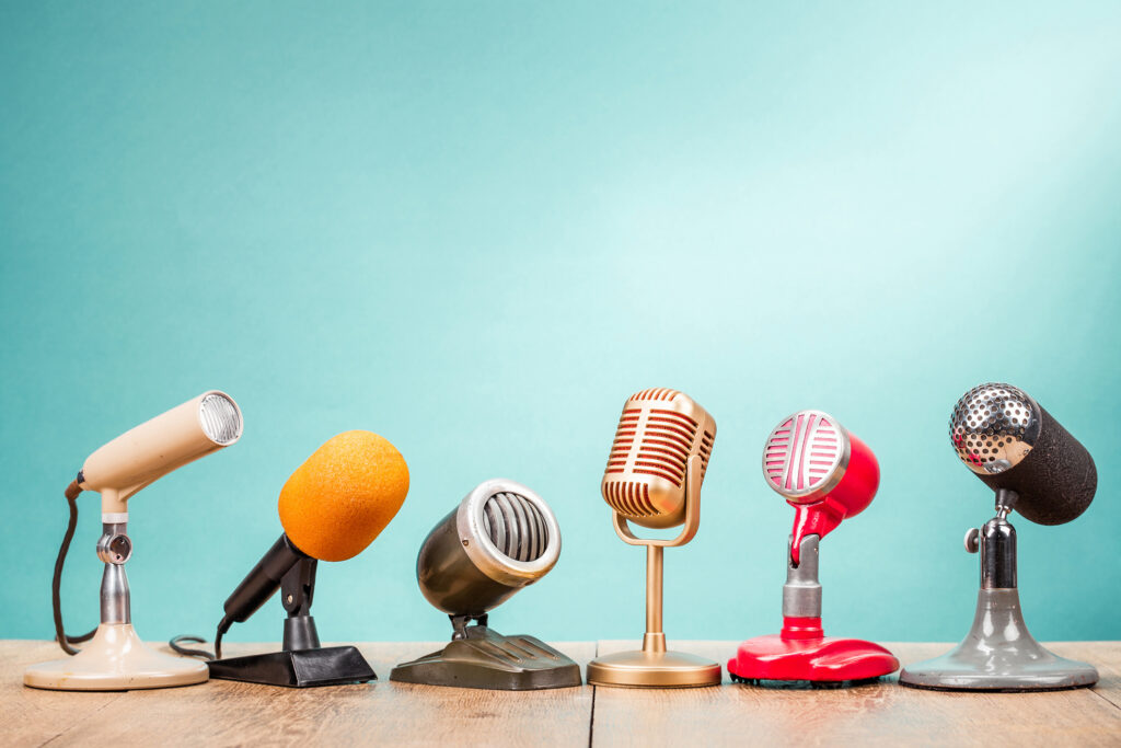 Retro old microphones sit on a table, showing the many media outlets for building brand presence