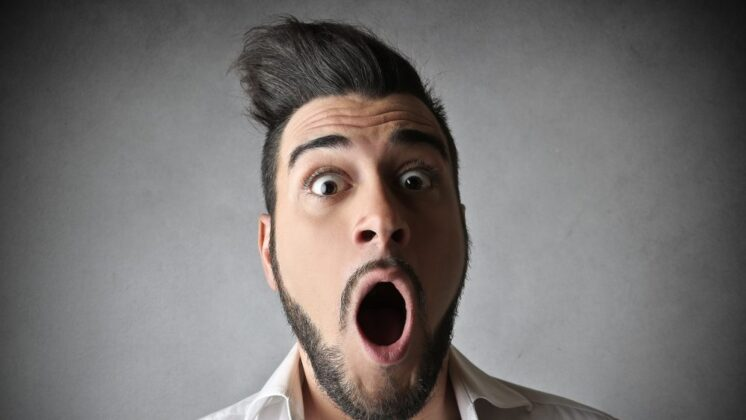 Man with a shocked face most people hope to create with killer event facilitation techniques