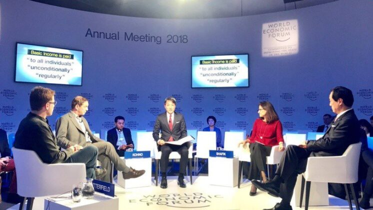 Attendees of the 2018 Davos Summit sit in a circle.