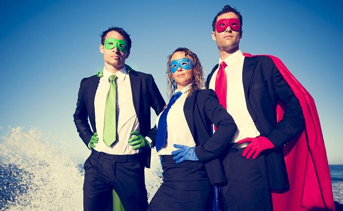 3 businesspeople in superhero masks and capes stand to face the threats outlined by the World Economic Forum 2015