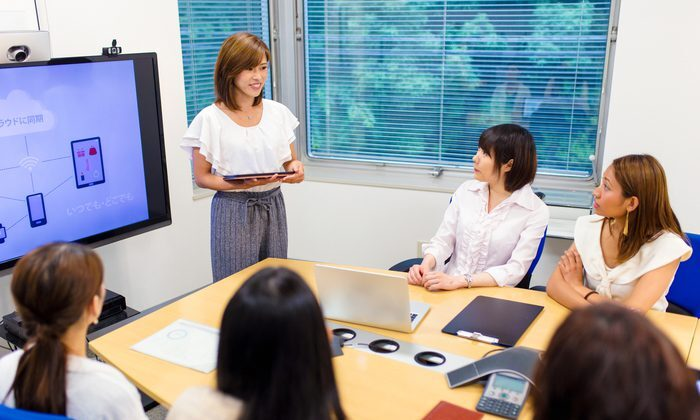 A woman expresses emotional intelligence while making a presentation