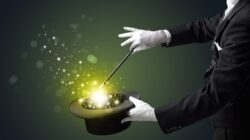 A magician taps his hat to reveal the magic within