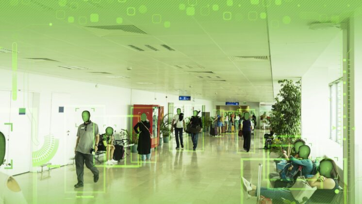 People walking through a corridor being identified by AI