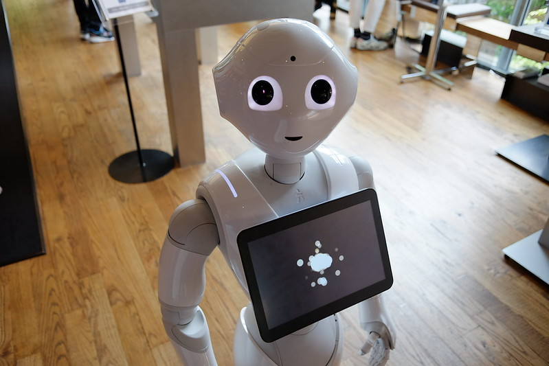 Pepper, a short white robot, helps out at a cafe in Tokyo.