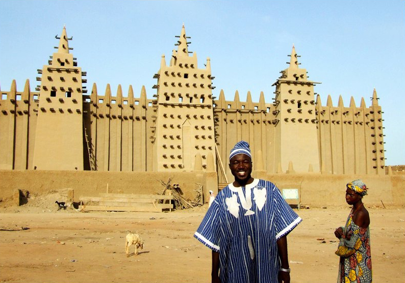 Dante Mahamoud poses in front of the Great Mosque of Djenné in Mali, his home country where he hopes to make social impact