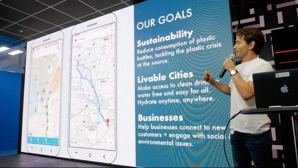 Robin Lewis presents the business goals of the mymizu social enterprise: sutsainability, livable cities, and businesses engaged with environmental issues.
