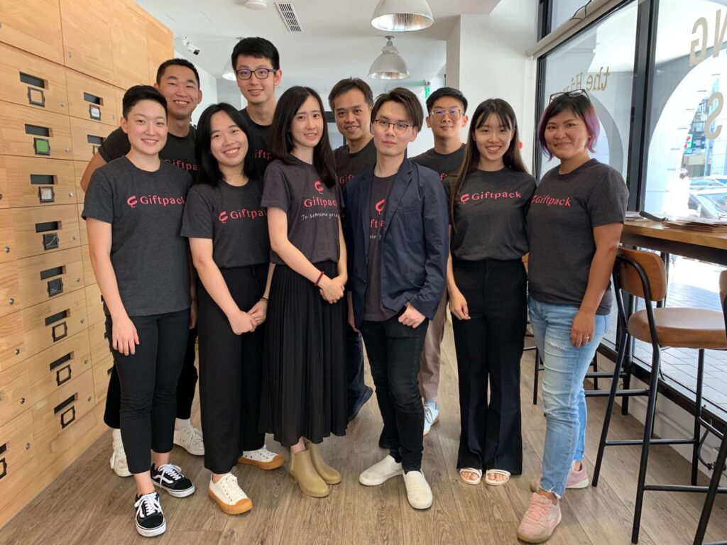 Ten members of the Giftpack team start around Arthur Chiang, the CEO.