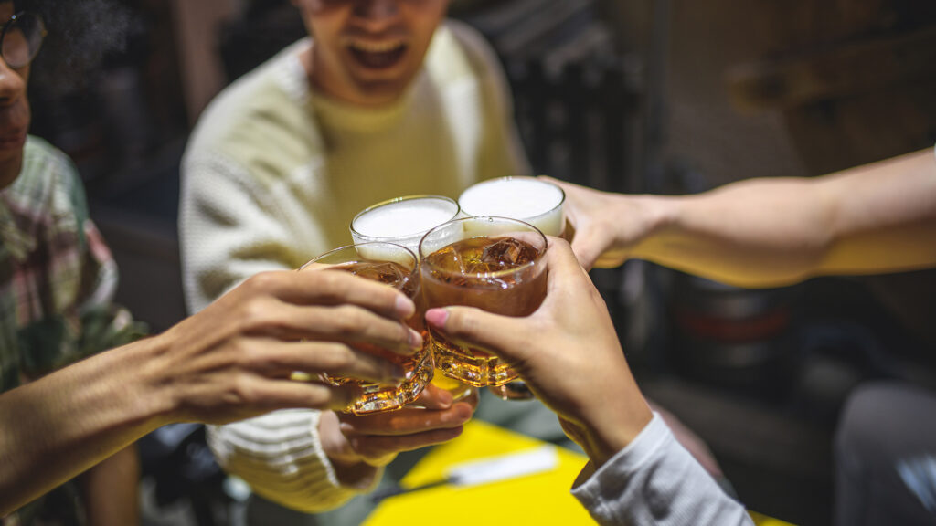 Japanese friends having a beer in a high-context culture observe rules about drink orders
