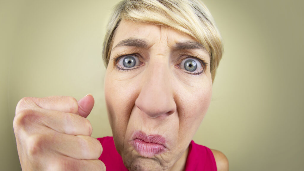 Angry face of a Karen customer who believes the customer is always right