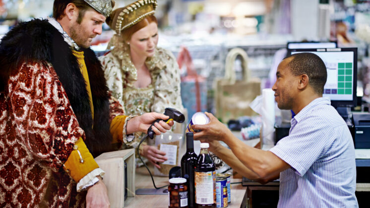 A king and queen buying groceries and paying at the cashier, unhappy to find the customer isn't always right