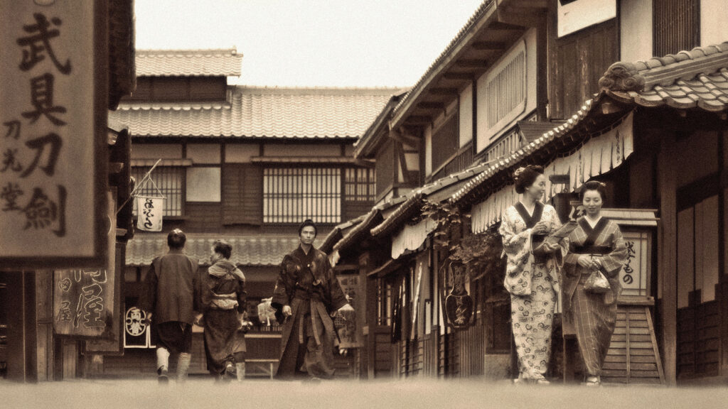 Old photograph of Japanese town with shops that achieved business longevity