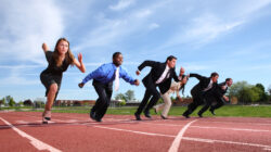 Business men and women set off on a race across a track, each determined to have the most successful product launch
