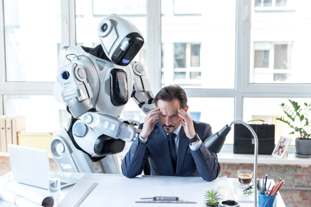 A robot stands over a stressed businessman in a suit, soothing him with its hands on his shoulders, dispelling the technology myths that robots will replace human jobs