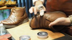 BENEXY staff performing shoe care on a pair of shoes, prolonging shoe life for health and fashion