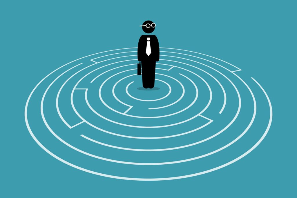 Icon of a businessman standing in a maze, showing how knowing if it's the right time to quit your job is partially about knowing the right path forward